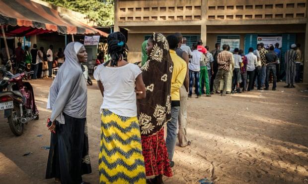 People queue outside a polling station in Ouagadougou, Burkina Faso