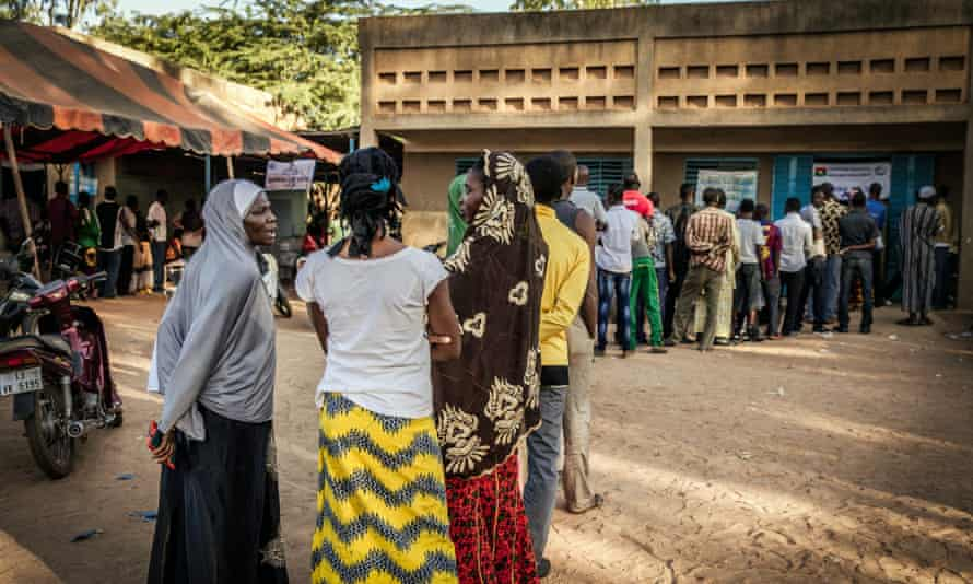 Burkinabe people line up at a polling station to cast their ballots in the general elections in Ouagadougou.