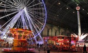 Fun fair at night at Le Grand Palais in Paris