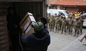 Employees of the suffrage, guarded by the military police, load a truck with election materials to be distributed for Sunday's parliamentary elections in La Paz, on Firday.