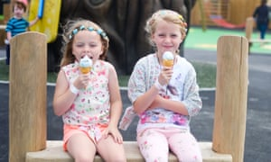 Two children sampling the wares at The Ice Cream Farm near Chester.