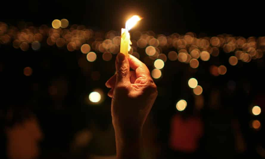 A person holds a candle