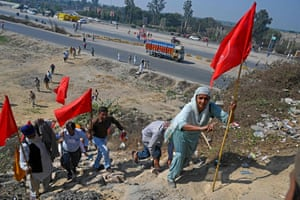 Kundli, India: protesters walk next to a national highway to block KMP Expressway during a demonstration called by farmers, as a part of their continuing protest against the central government's recent agricultural reforms, in Haryana state