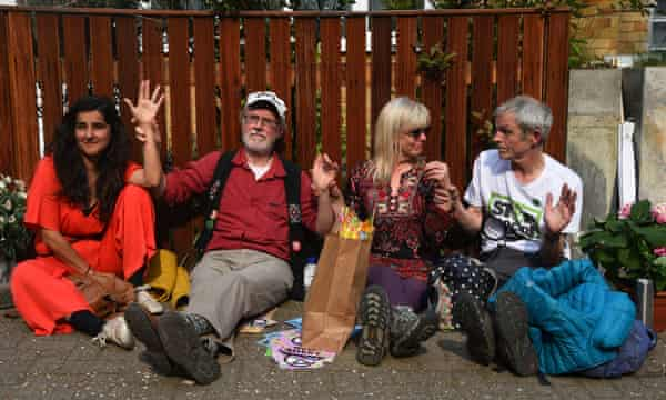 Members of Extinction Rebellion who glued to Jeremy Corbyn's fence.