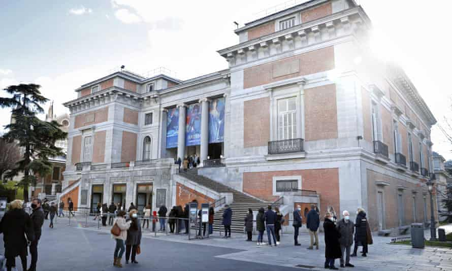 Visitors queue up to enter the Prado in Madrid.