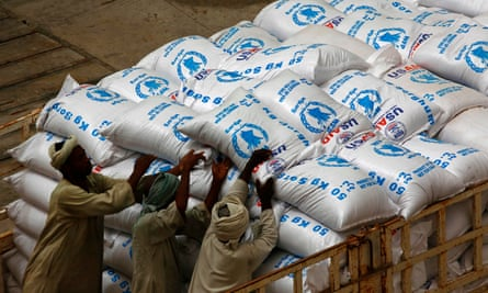 Food aid provided by USAID and destined for South Sudan being unloaded at Port Sudan last year.