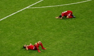 The Iranian players are disappointed after the final whistle.