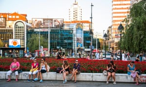 Women resting along flower beds in Republic Square, Belgrade.