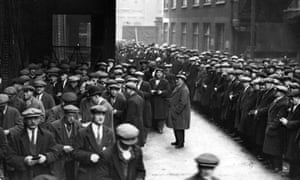 Labourers queue for work at the London docks in 1931.