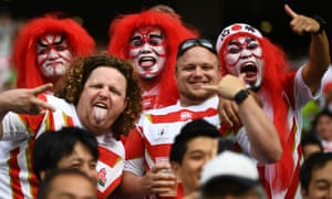 Japan fans enjoy their victory over Ireland at the Rugby World Cup.