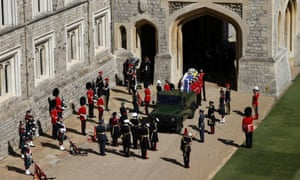 The hearse, a specially modified Land Rover, drives on the grounds of Windsor Castle
