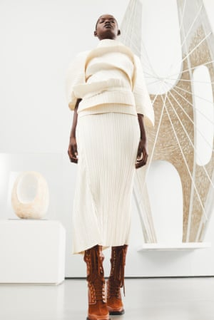 Dress, by Issey Miyake. Boots (worn throughout), by JW Anderson. Pictured with (left) Spring (1966) and Winged Figure (1961-62), both by Barbara Hepworth.