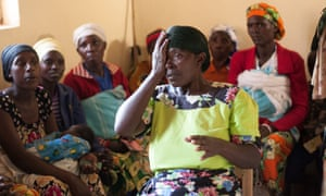 A woman at the health centre covers one eye to test her vision