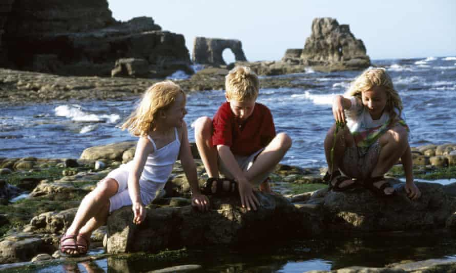 Children playing in a rock pool at the Wherry, to the south of Souter Lighthouse.