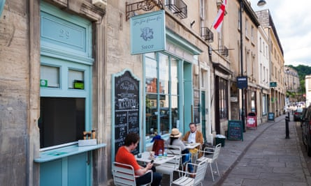 The Fine Cheese Co Company shop in Walcot Street, Bath, Somerset, England, UK. People sit at pavement tables outside in front.