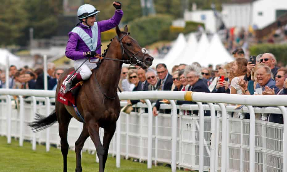 Oisin Murphy celebrates with Alcohol Free after the Sussex Stakes at Goodwood.