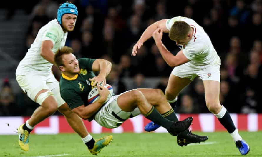 South Africa's André Esterhuizen (centre) is tackled by Owen Farrell (of England during Saturday's Test at Twickenham.