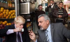Boris Johnson has a coffee with Ziad al-Bandak, an adviser to the Palestinian president