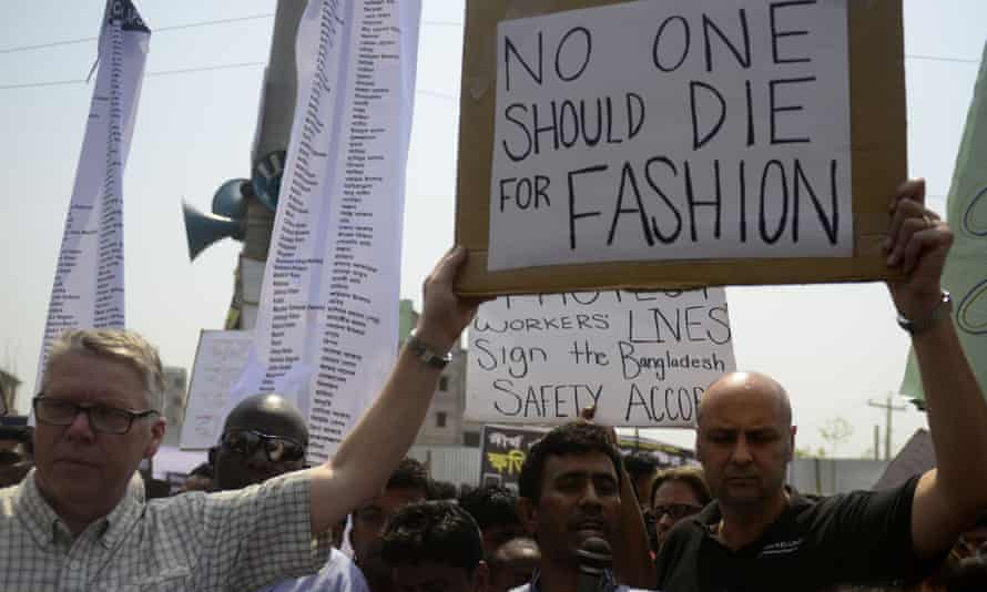 Bangladeshi activists and relatives of the victims of the Rana Plaza building collapse take part in a protest marking the first anniversary of the disaster at the site where the building once stood, in Savar, on the outskirts of Dhaka.