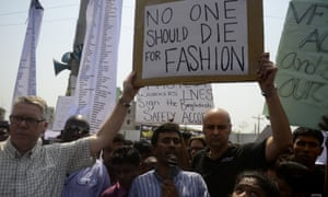Bangladeshi activists and relatives of the victims of the Rana Plaza building collapse take part in a protest on 24 April 2014 marking the first anniversary of the building collapse that killed 1,138 workers in the world's worst garment factory disaster.