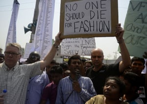 Bangladeshi activists and relatives of the victims of the Rana Plaza building collapse take part in a protest marking the first anniversary of the disaster at the site where the building once stood on the outskirts of Dhaka on April 24, 2014. More than 1,100 workers died in the world's worst garment factory disaster. Photo: Munir uz ZAMANMUNIR UZ ZAMAN/AFP/Getty Images