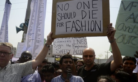 Bangladeshi activists and relatives of the victims of the Rana Plaza building collapse take part in a protest marking the first anniversary of the disaster in 2014.