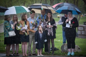 Multiple generations grieve at the memorial service.