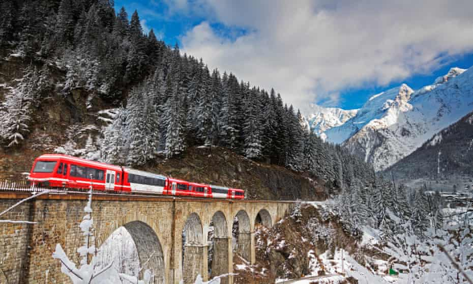Red Mont Blanc Express train going over a viaduct in Haute Savoie, France.