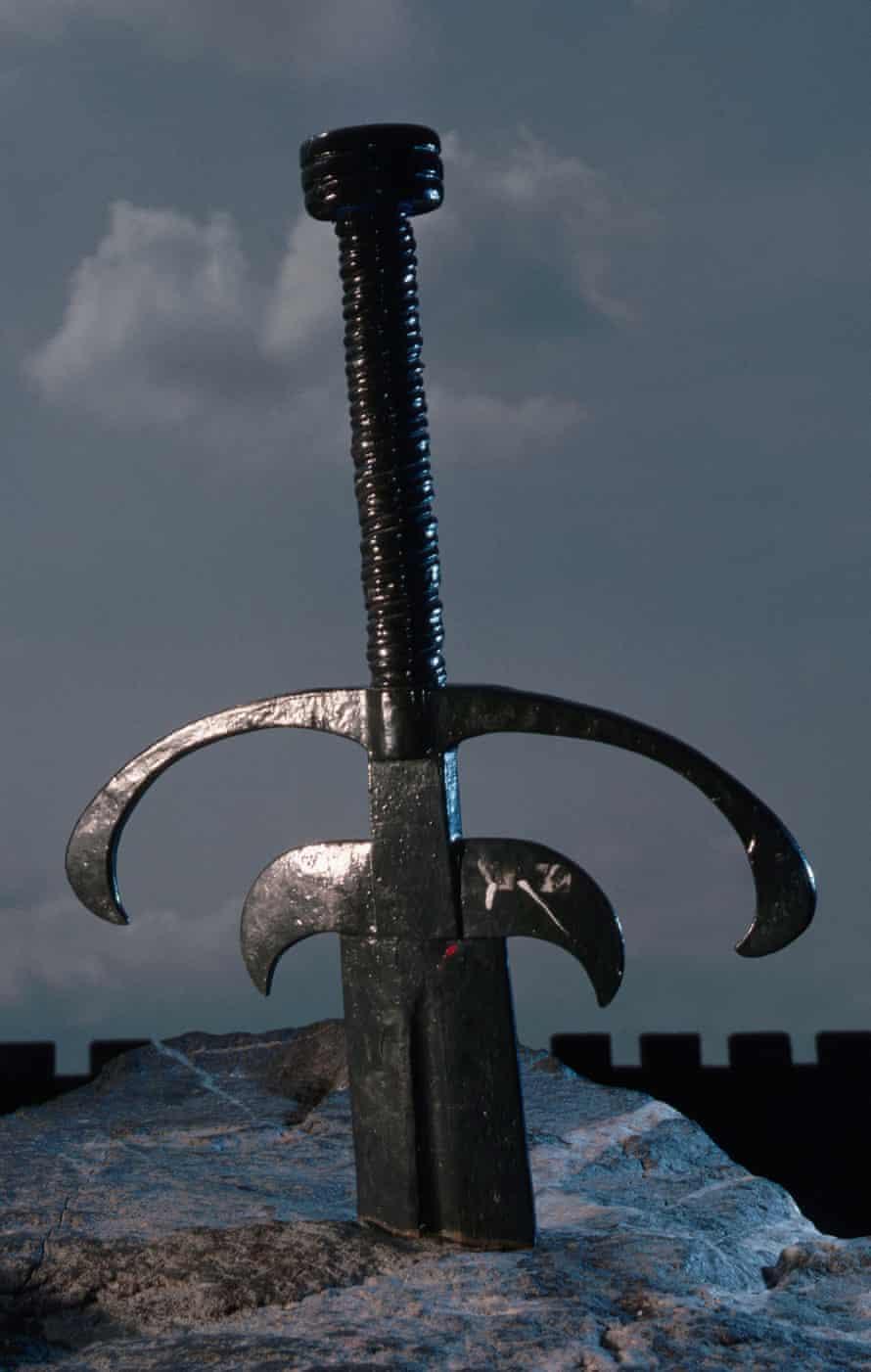 The legendary King Arthur's sword embedded in stone.
