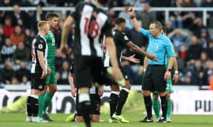 Newcastle United's Sean Longstaff is shown a red card by referee Kevin Friend.