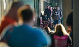 People line up outside Kentucky Career Center prior to its opening to find assistance with their unemployment claims in Frankfort, Kentucky.