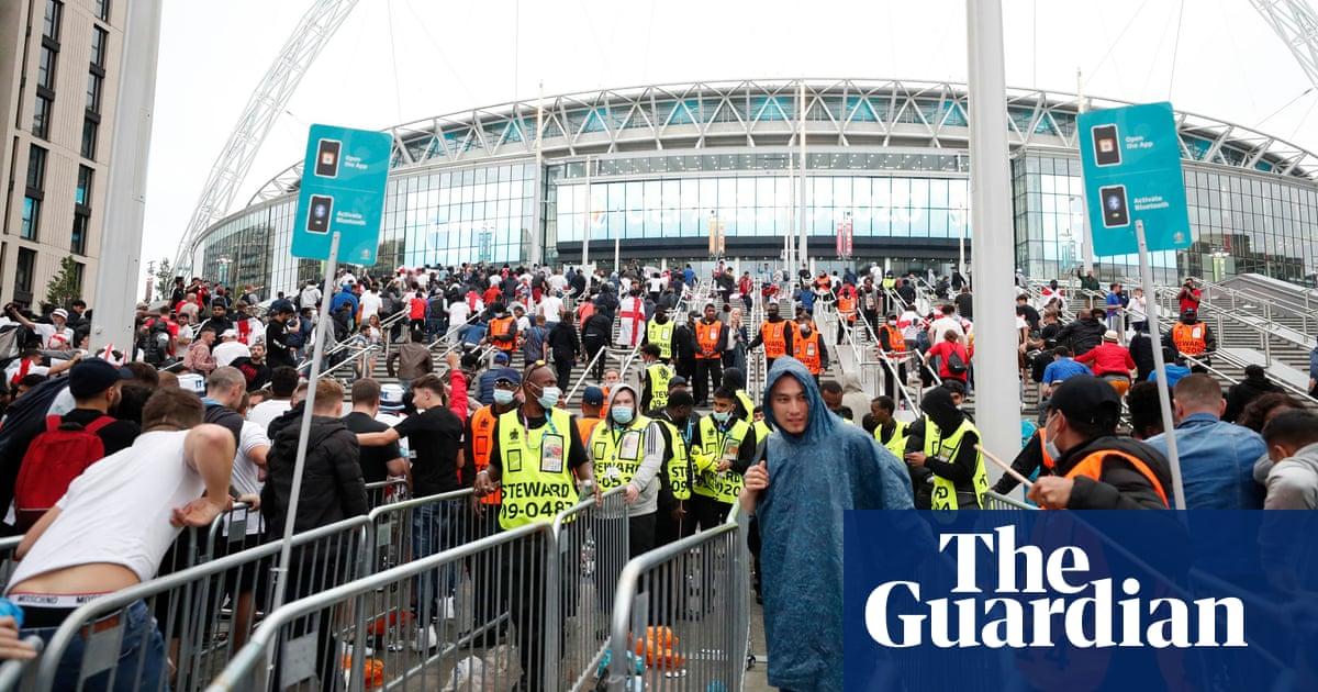 Two men arrested over ticketless fans storming England Wembley final