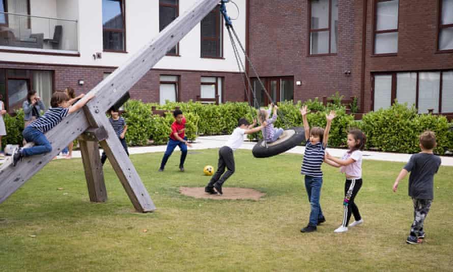 Lilian Baylis Estate residents use the playground