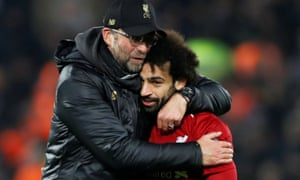 Juergen Klopp celebrates with Mohamed Salah at the end of the match.