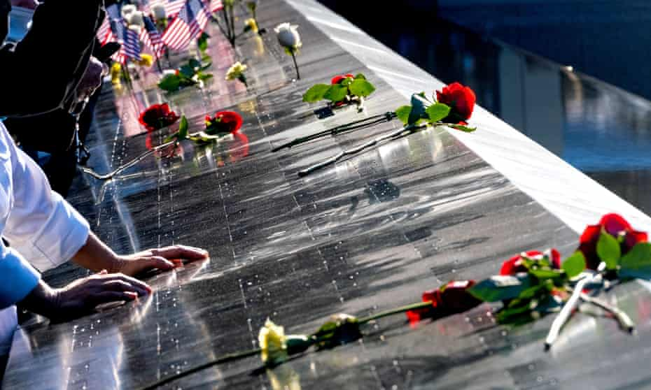 Roses adorn the names of the victims during a ceremony commemorating the 20th anniversary of the 9/11 attacks.
