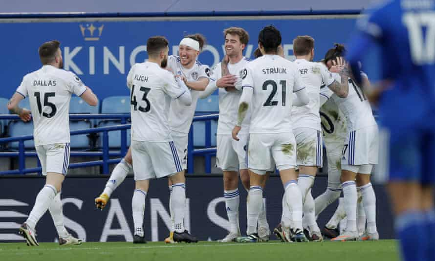 Leeds players celebrate after their third goal during a 3-1 victory against Leicester at the King Power Stadium.