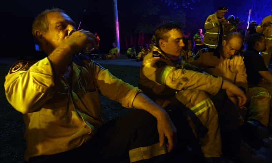Firefighters take a break in Nana Glen, NSW.