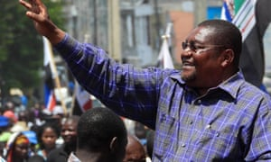 Ossufo Momade, president of Renamo, waves to supporters in Nampula
