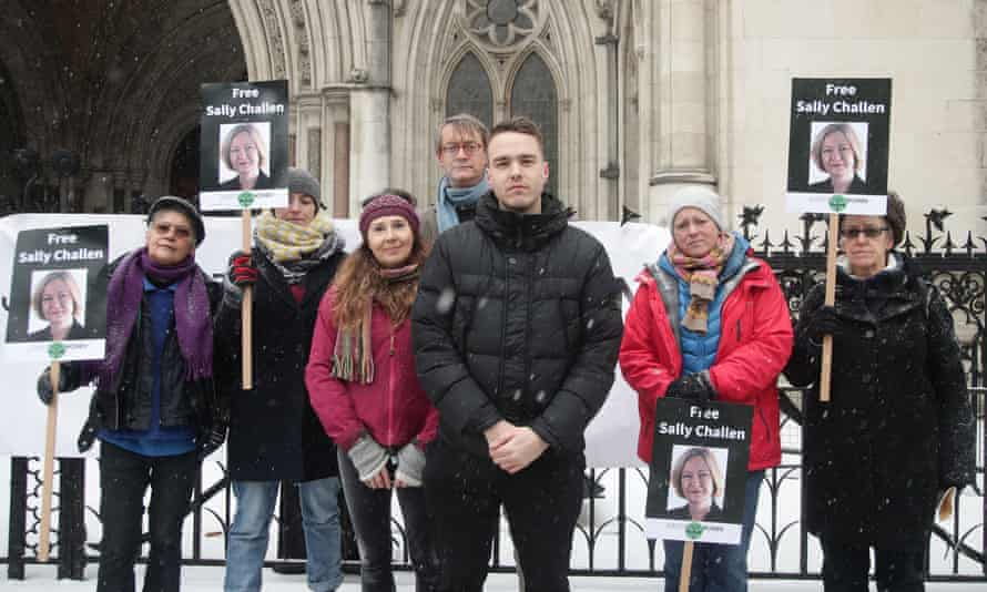 Sally Challen's son, David (centre), with members of Justice for Women protesting outside the Royal Courts of Justice.