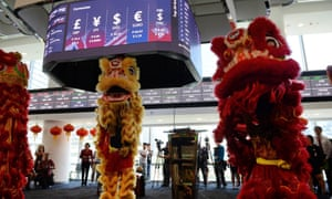 Dancers perform a dragon dance for good fortune at the Philippine Stock Exchange today.