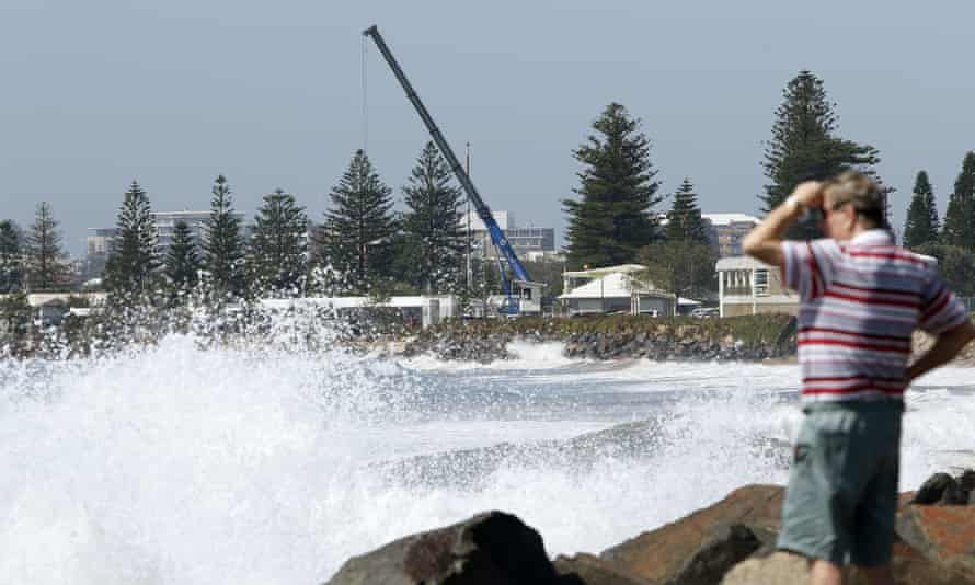 Newcastle City council uses a crane to move cabins from the Stockton caravan park