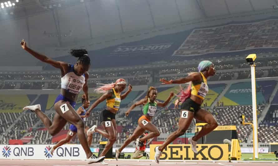 Shelly-Ann Fraser-Pryce (right) wins the world championship 100m ahead of Britain's Dina Asher-Smith ((left).