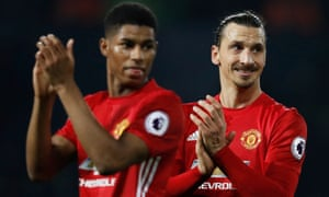 Manchester United's Zlatan Ibrahimovic, right, and Marcus Rashford applaud fans after the game.