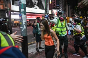 A bystander reacts after police fire teargas in the Causeway Bay district