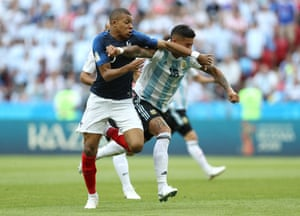 Marcos Rojo of Argentina fouls Kylian Mbappe of France to concede a penalty.