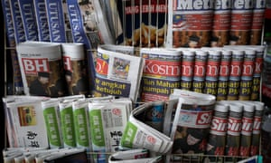 Newspapers showing headlines about Mahathir Mohamad being sworn-in as Malaysia's new prime minister at a convenience shop in Kuala Lumpur