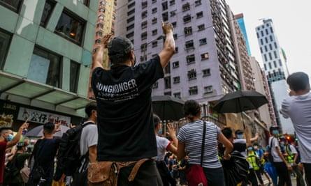 hong kong protester in street