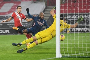 Arsenal's French striker Alexandre Lacazette (C) scores his team's third goal.