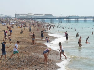 People enjoy the hot weather on Brighton Beach.