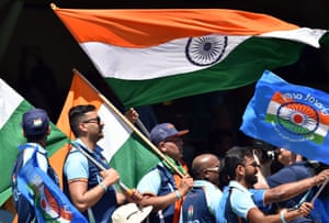 Indian fans wave national flags during day one of the first cricket Test match between Australia and India at the Adelaide Oval.